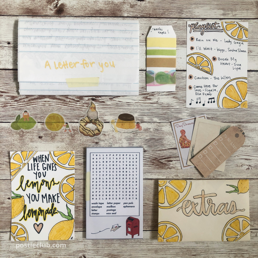 organized flat lay of washi tape, playlist card, pocket word search puzzle, DIY envelope, and DIY quote card all with a lemon theme